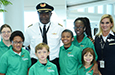 Students pose with Pilot James Wakefield.