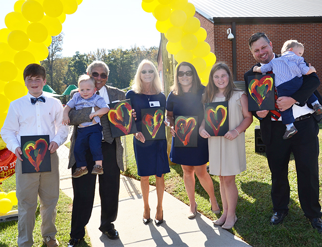 The Levkoff family members were the first to receive original paintings by the Cedar Springs Academy students.
