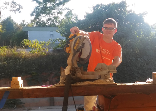 Paul Watson cuts wood for a project at Green River Log Cabins.