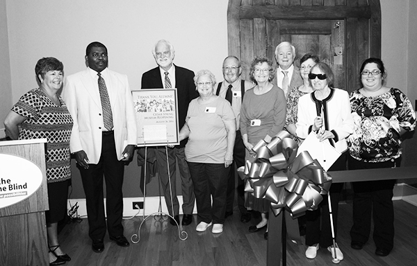 President Page McCraw and board member Bob Morrow presented a framed poster to express appreciation to the alumni.
